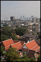 Temple rooftop and modern skyline. Bangkok, Thailand ( color)