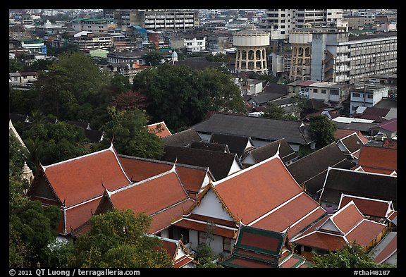Temple roofs and modern buildings from above. Bangkok, Thailand (color)
