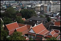 Temple roofs and modern buildings from above. Bangkok, Thailand ( color)