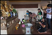 Worshippers with lotus inside Wat Saket. Bangkok, Thailand