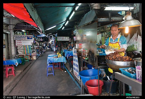 Food stall in alley. Bangkok, Thailand (color)