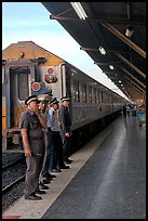 Attendants and train, Hualamphong station. Bangkok, Thailand (color)