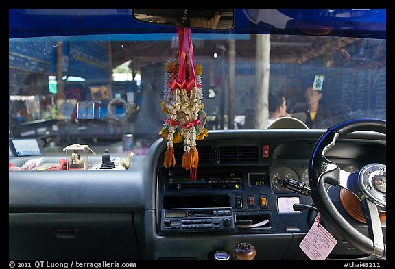 Bus dashboard with religious items. Thailand (color)