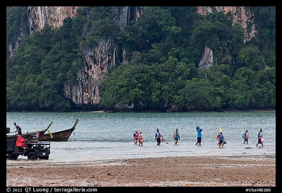Disembarking at low tide, Rai Leh East. Krabi Province, Thailand (color)