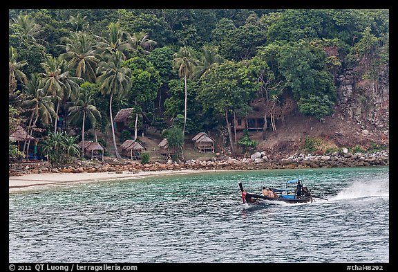 Long tail boat and beach cabins, Ko Phi Phi. Krabi Province, Thailand (color)