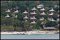 Beach and hillside bungalows on stilts, Ko Phi-Phi island. Krabi Province, Thailand (color)