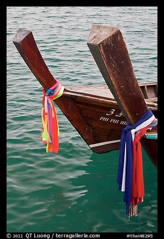 Ribons on prow of two longtail boats, Ko Phi-Phi Don. Krabi Province, Thailand (color)