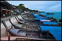 Boats and waterfront houses at dusk Ao Ton Sai, Ko Phi-Phi Don. Krabi Province, Thailand (color)