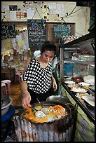 Woman preparing Pad Thai, Phi-Phi island. Krabi Province, Thailand (color)