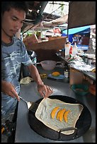 Man preparing thai pancake, Tonsai village, Ko Phi Phi. Krabi Province, Thailand (color)
