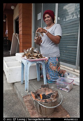 Woman selling grilled seafood, Tonsai village, Ko Phi-Phi island. Krabi Province, Thailand (color)