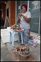 Woman selling grilled seafood, Tonsai village, Ko Phi-Phi island. Krabi Province, Thailand ( color)
