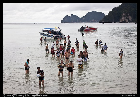 Asian tourists wading in water, Ko Phi Phi. Krabi Province, Thailand (color)