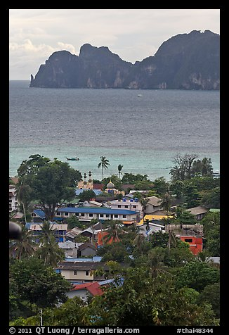 Village, bay and cliffs, Ko Phi-Phi island. Krabi Province, Thailand (color)