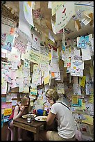 Women eating at Pad Thai restaurant decorated with customer notes, Ko Phi-Phi Don. Krabi Province, Thailand ( color)