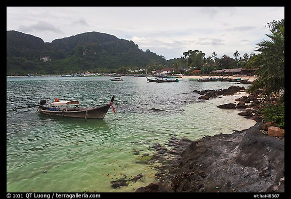 Long tail boat, and Tonsai village, Ko Phi-Phi Don. Krabi Province, Thailand (color)