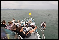 Passengers on prow of boat. Krabi Province, Thailand (color)