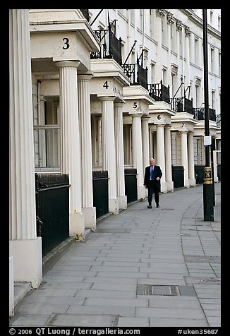 Businessman walking down near townhouses crescent. London, England, United Kingdom (color)
