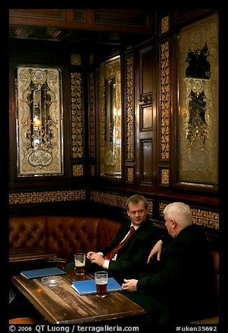 Business men talking over a beer, Victorian boozer Princess Louise. London, England, United Kingdom (color)