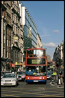 Double decker busses in a busy street. London, England, United Kingdom (color)