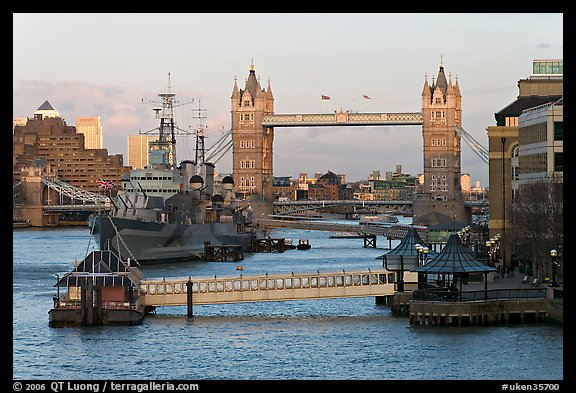 Historic boats, quays along the Thames, and Tower Bridge, late afternoon. London, England, United Kingdom (color)