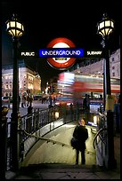 Man entering underground, and motion-blurred double decker bus,  Piccadilly Circus. London, England, United Kingdom (color)