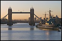 London Bridge, River Thames, and cruiser HMS Belfast at sunrise. London, England, United Kingdom
