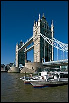 Catamaran below Tower Bridge. London, England, United Kingdom (color)
