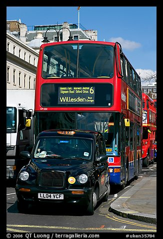 Taxi and double decker bus. London, England, United Kingdom (color)