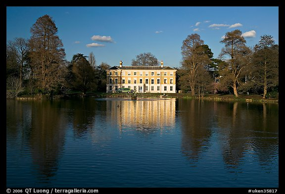 Museum No 1 reflected in lake, late afternoon. Kew Royal Botanical Gardens,  London, England, United Kingdom (color)