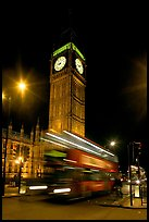 Big Ben and double decker bus in motion at nite. London, England, United Kingdom ( color)