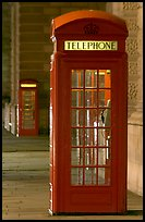 Red phone booth at night. London, England, United Kingdom (color)