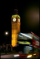 Double-decker bus in motion and Big Ben at night. London, England, United Kingdom (color)