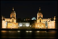 Old Royal Naval College, Queen's house, and Royal observatory with laser marking the Prime meridian at night. Greenwich, London, England, United Kingdom (color)