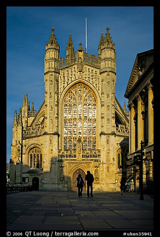 West facade of Bath Abbey with couple silhouette, late afternoon. Bath, Somerset, England, United Kingdom (color)
