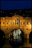 Central section of Pulteney Bridge, covered by shops,  at night. Bath, Somerset, England, United Kingdom ( color)