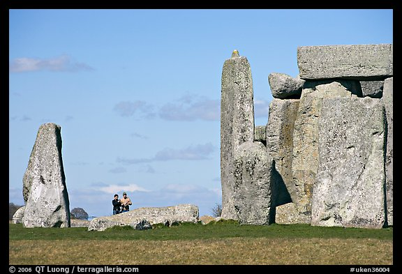 Couple looking at the standing stones, Stonehenge, Salisbury. England, United Kingdom (color)