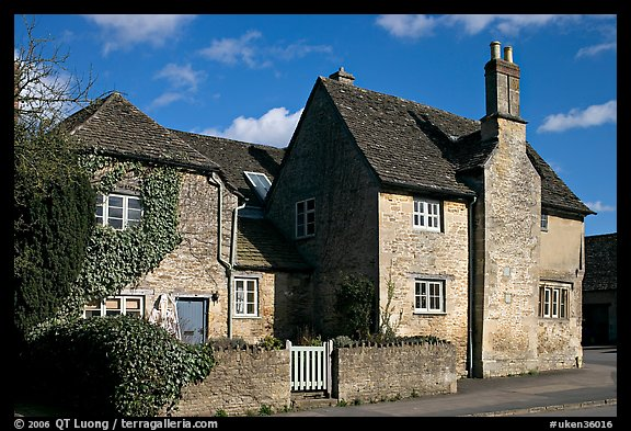 Houses with roofs made from split natural stone tiles, Lacock. Wiltshire, England, United Kingdom (color)
