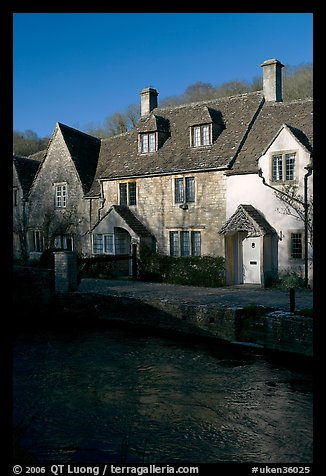 Cotswold type cottages and Bybrook River, Castle Combe. Wiltshire, England, United Kingdom (color)