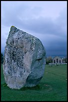 Standing stone and chapel at dusk, Avebury, Wiltshire. England, United Kingdom (color)