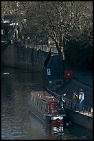 Family stepping out of houseboat onto quay. Bath, Somerset, England, United Kingdom (color)