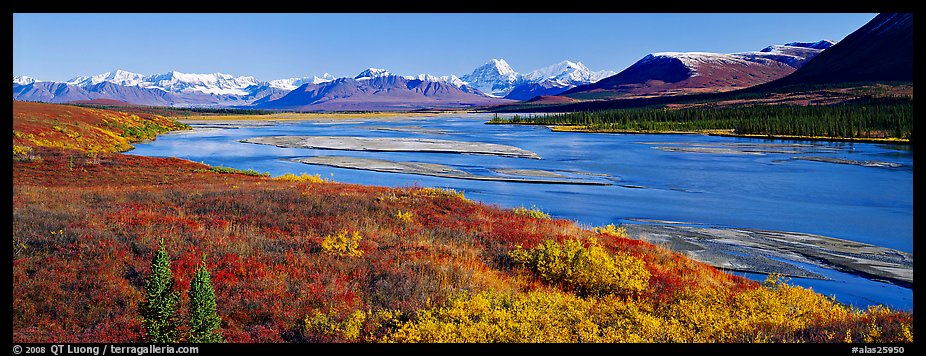Tundra autumn scenery with wide river and mountains. Alaska, USA (color)