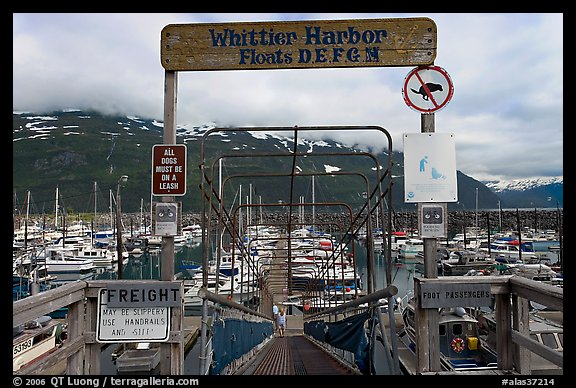 Ramp to harbor deck with Whittier sign. Whittier, Alaska, USA (color)