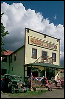 Ma Johnson hotel with classic car parked by, afternoon. McCarthy, Alaska, USA