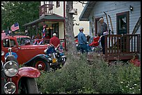 Vintage cars and houses on main street. McCarthy, Alaska, USA (color)