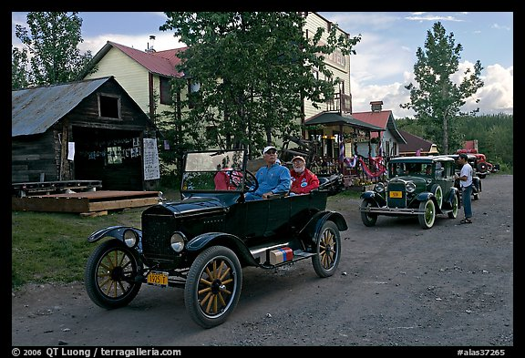 Classic cars driven on main street. McCarthy, Alaska, USA (color)