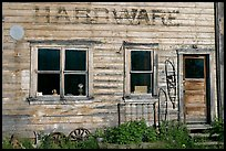 Windows and doors of old hardware store. McCarthy, Alaska, USA (color)