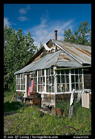 House with antlers and american flag. McCarthy, Alaska, USA (color)