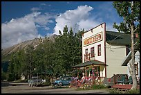 Hotel, main street, vintage car, and truck. McCarthy, Alaska, USA (color)
