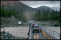 Four wheeler crossing the footbridge. McCarthy, Alaska, USA (color)